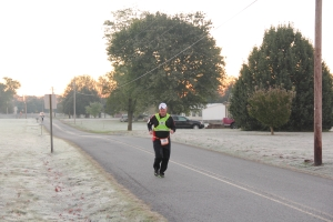 Rob Brown runs in the early morning light as the sun rises and the frost covers the ground. Temperatures dropped 30 degrees overnight
