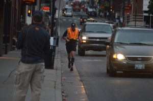 Pat Sullivan runs through downtown Nashville towards finish line