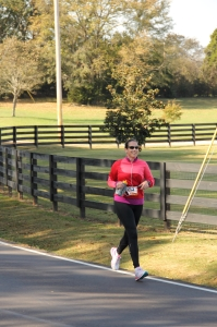Jennifer Harbaugh pushes through her last leg through the beautiful horse farms just out side Nashville