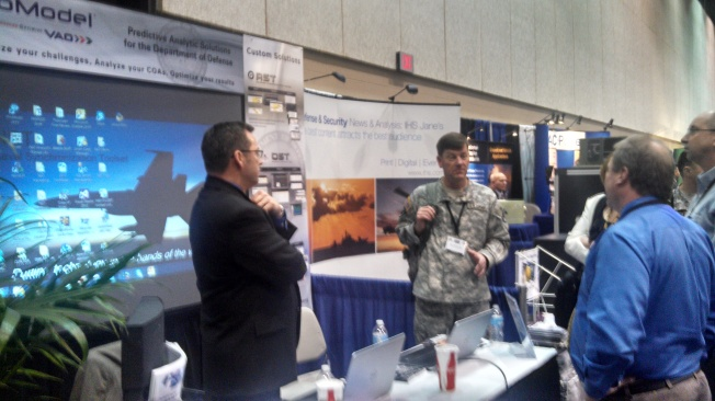 Major General Collyar, CG at AMCOM, stops by our booth at the AUSA Winter Symposium to talk with ProModel CEO Keith Vadas (right) and ProModels Director of Navy Programs Robert Wedertz (left)