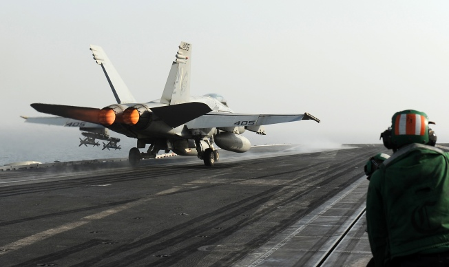 120613-N-VO377-095  ARABIAN GULF (June 13, 2012) An F/A-18C Hornet assigned to the Blue Blasters of Strike Fighter Squadron (VFA) 34 launches from the flight deck of the Nimitz-class aircraft carrier USS Abraham Lincoln (CVN 72). Lincoln is deployed to the U.S. 5th Fleet area of responsibility conducting maritime security operations, theater security cooperation efforts and combat flight operations in support of Operation Enduring Freedom. (U.S. Navy photo by Mass Communication Specialist 2nd Class Jonathan P. Idle/Released)